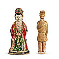 A cizhou painted figure of a lady, southern song - jin dynasty, and a straw-glazed figure of a groom, tang dynasty