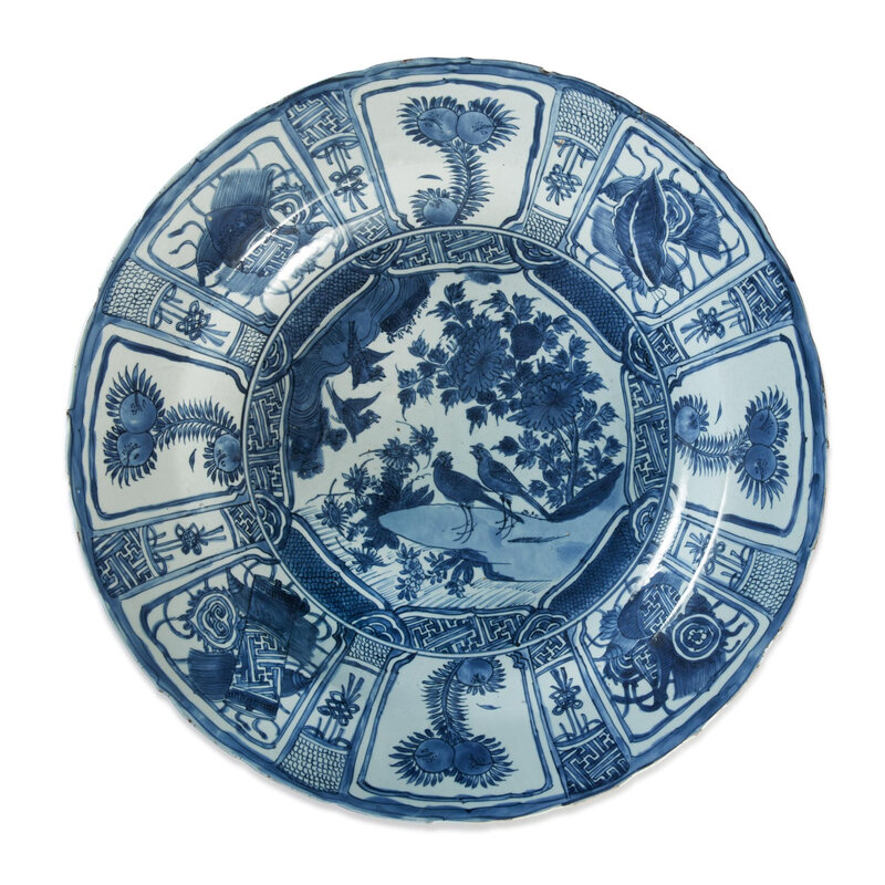 A large blue and white barbed-rim 'Birds in rockry' Kraak dish, late Ming dynasty