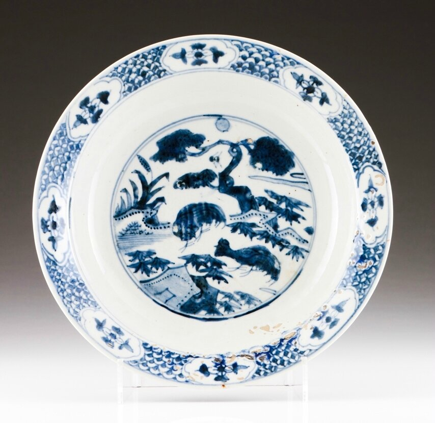 A Chinese porcelain charger, Ming dynasty, late 14th-early 15th century