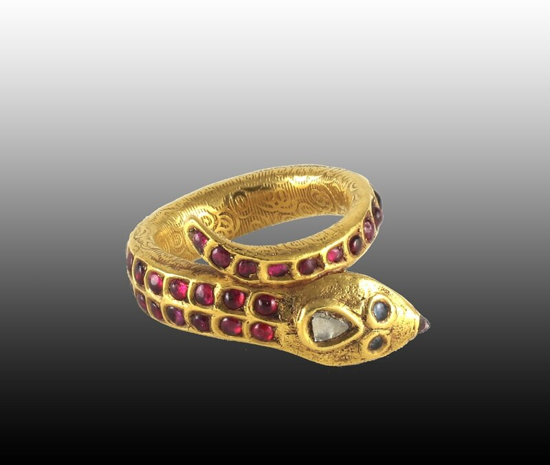 A ruby and gold snake ring, South India, 19th Century