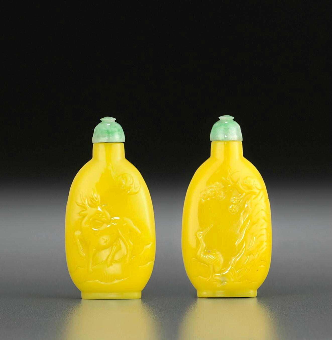 A carved yellow glass snuff bottle, possibly Imperial, attributed to Palace Workshops, Beijing, 1730-1820