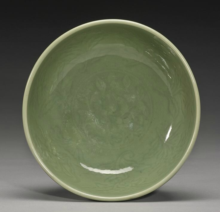 A carved 'Longquan' deep bowl, Ming Dynasty, Yongle period2