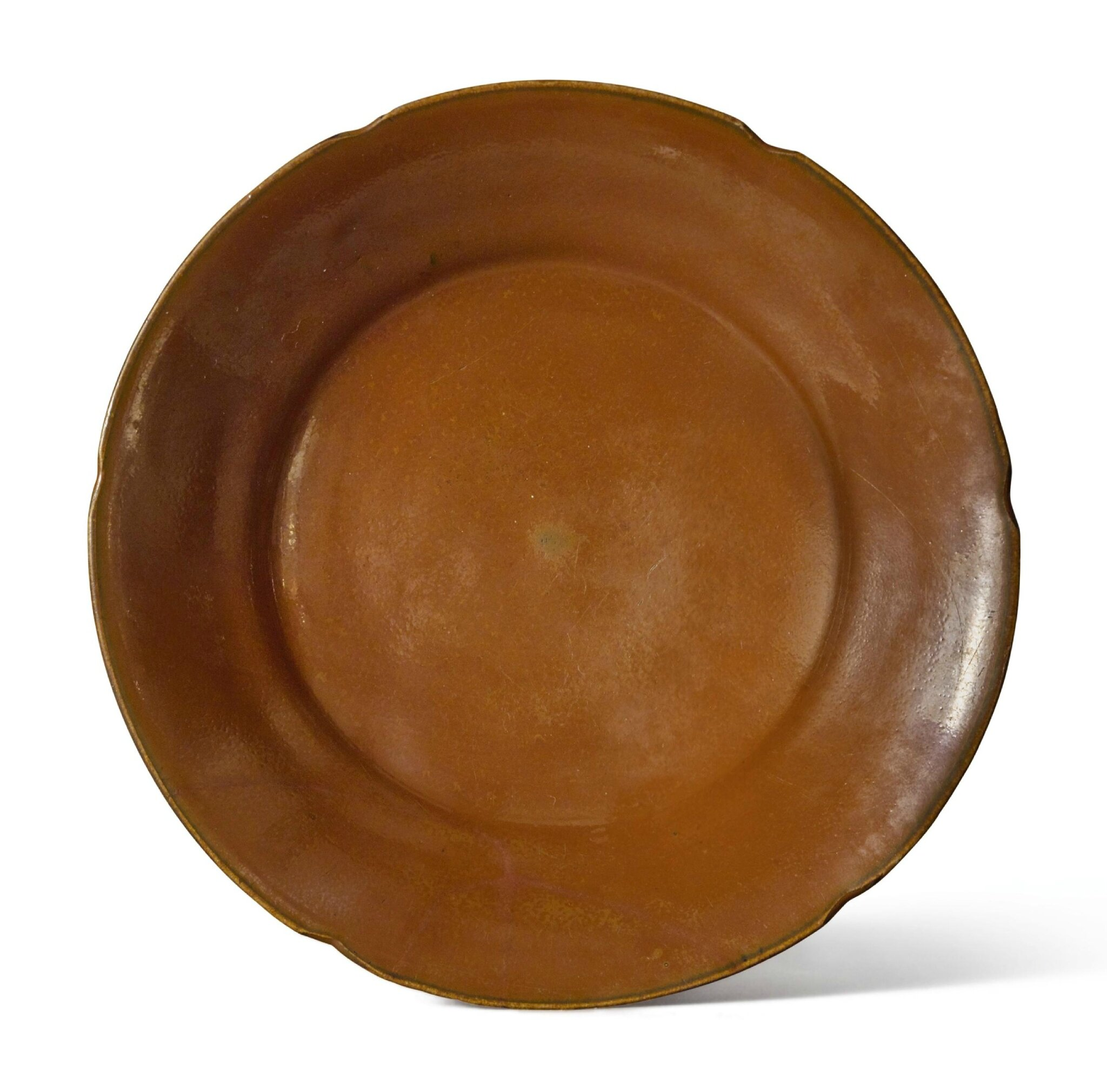 A rare persimmon-glazed 'Ding'-type mallow-form dish, Northern Song dynasty (960–1127)