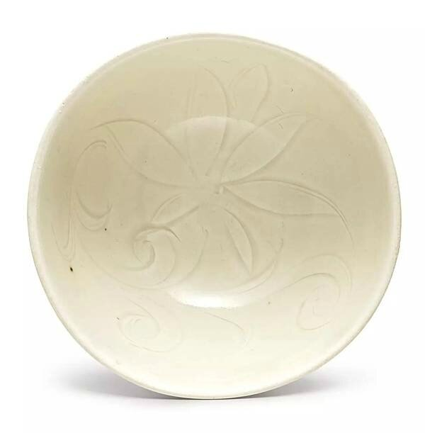 A smallcarved 'Ding' white-glazed 'lotus' bowl, Song dynasty