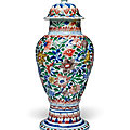 A wucai moulded slender baluster vase and cover, qing dynasty, kangxi period (1662-1722)