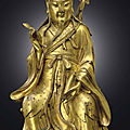A very rare gilt-bronze figure of lu dongbin, yuan-early ming dynasty, 13th-14th century