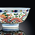A wucai 'dragon and phoenix' bowl, kangxi underglaze blue six-character mark and of the period (1662-1722)