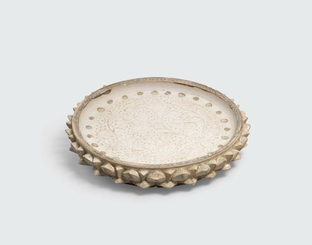 A small lotus-petal dish with incised decoration, Lý dynasty, 11th-13th century
