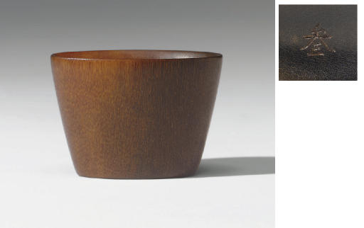 An unusual small rhinoceros horn oval measuring cup, 18th-19th century