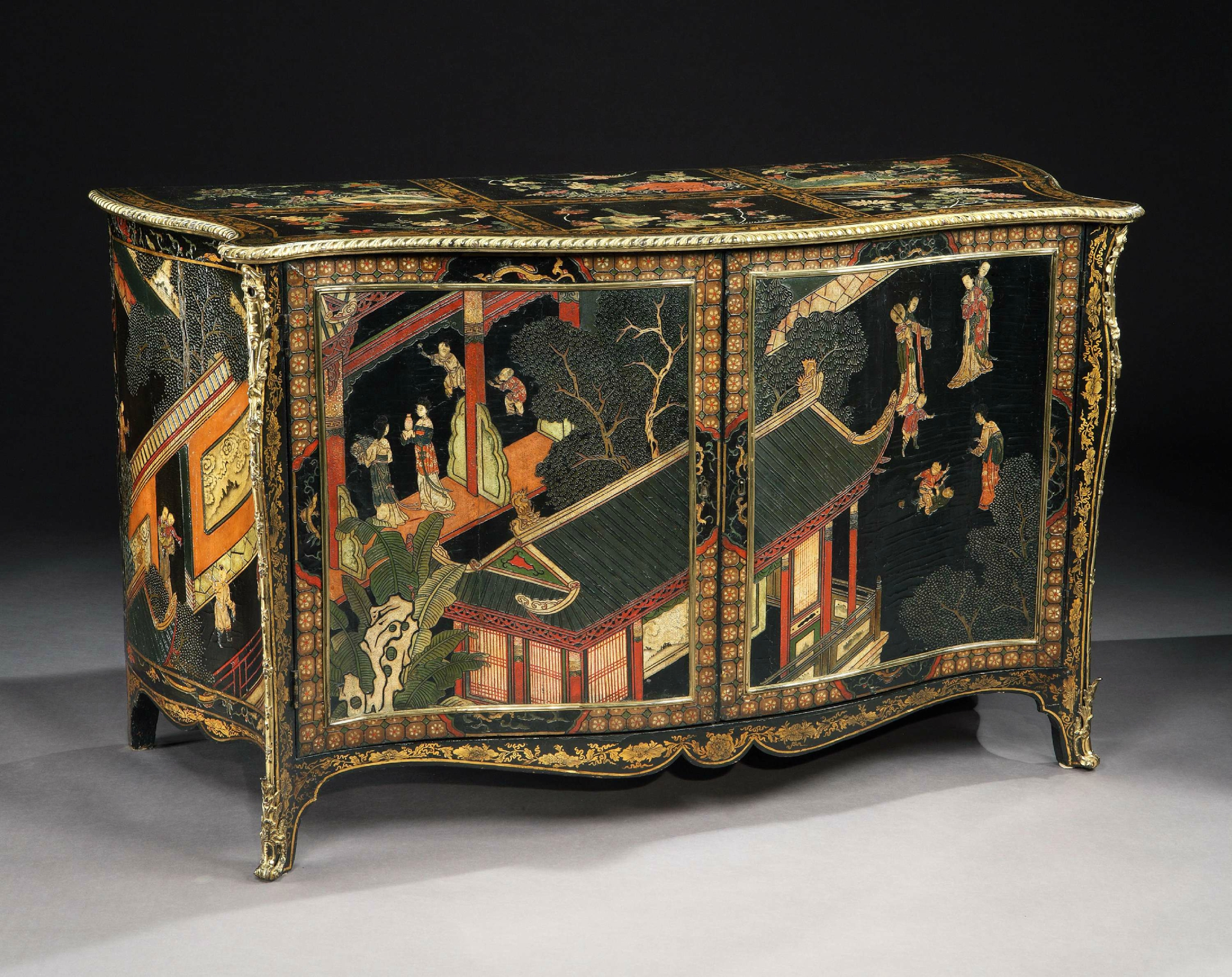 a magnificent pair of george iii period ormolu mounted coromandel lacquer and black gilt japanned serpentine commodes