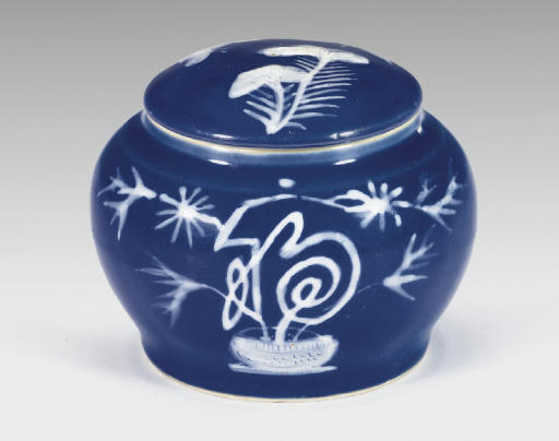 A rare slip-decorated blue-glazed jar and cover, Ming dynasty, 16th century