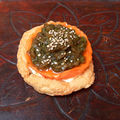 Roasted bell pepper cheasecake on a parmesan pavlova with tangy green chutney