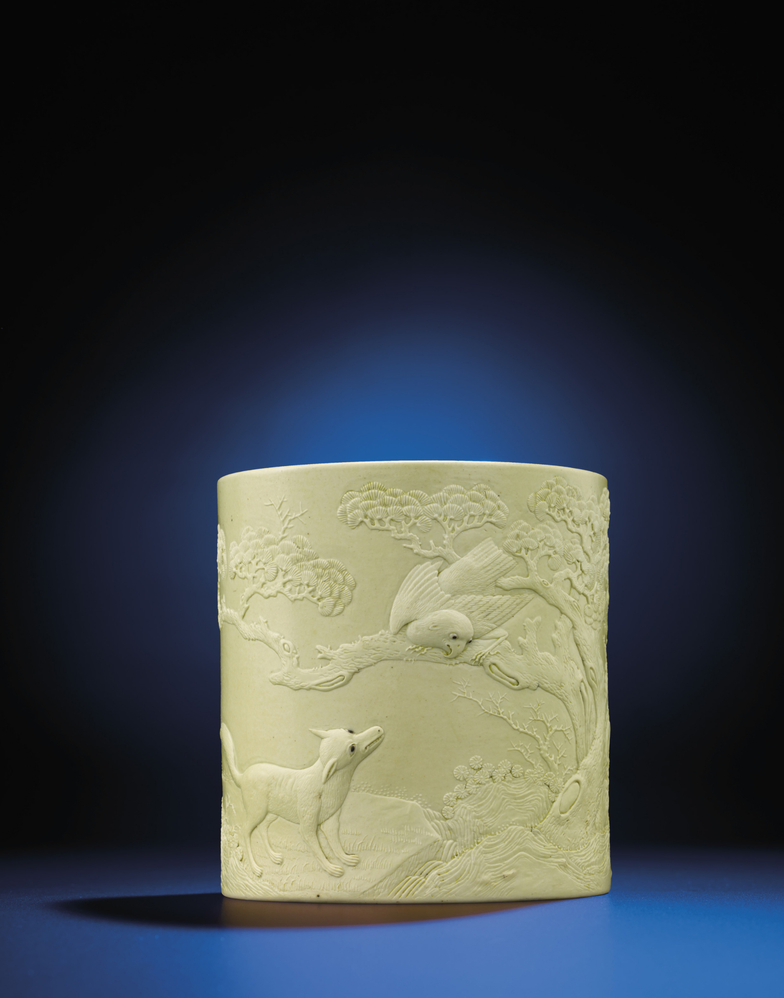 A carved yellow-enamelled brush pot, Daoguang period (1821-1850)