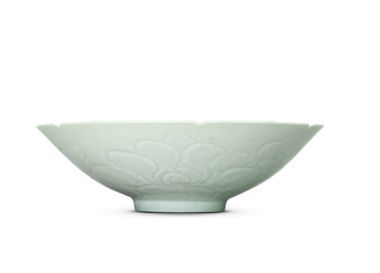 A rare carved Qingbai foliate 'chilong' bowl, Southern Song Dynasty (1127-1279)