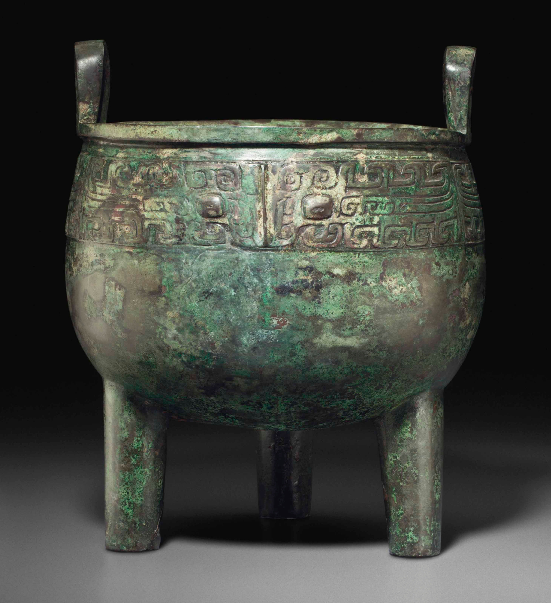 A large bronze ritual tripod food vessel, Ding, Late Shang-Western Zhou dynasty, 11th century BC