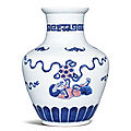 A fine and very rare underglaze-blue and copper-red 'lion' vase, qianlong mark and period (1736-1795)