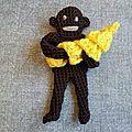 Singe et son régime de bananes