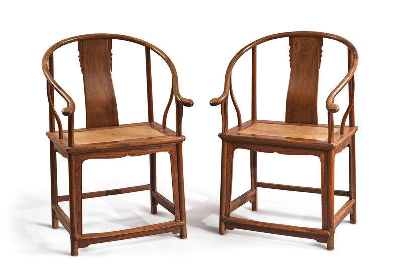 A pair of 'huanghuali' horseshoe-back armchairs, quanyi, Qing dynasty, 18th century