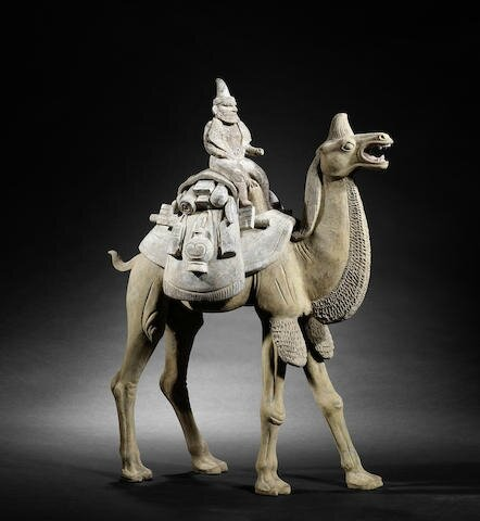 A very large pottery model of a camel and rider, Tang Dynasty