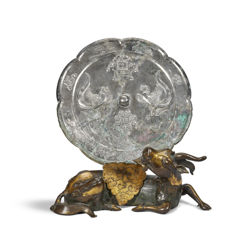 Liao dynasty (907-1125) bronze mirror and a parcel-gilt bronze mythical beast-form mirror stand, Yuan-Ming Dynasty (1279-1644)
