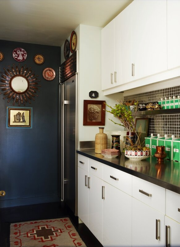 eclectic-kitchen-blue-wall-black-mini-tile-native-rug