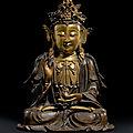 A large parcel-gilt-bronze figure of guanyin,