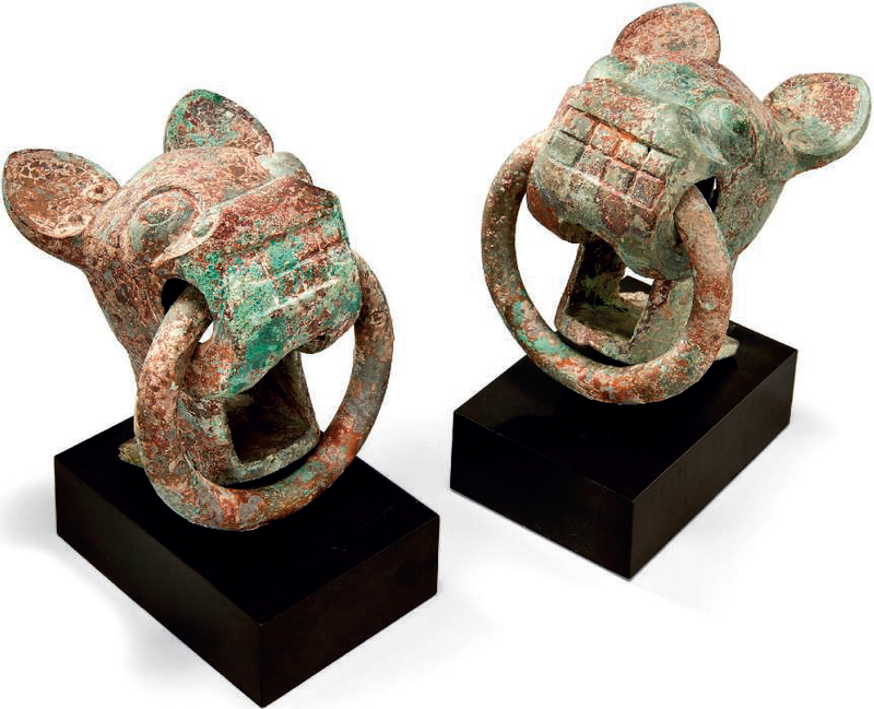 A pair of archaic bronze animal-head chariot fittings, Warring States period (475-221 BC)