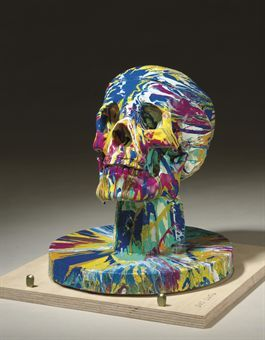 Damien Hirst (b. 1965) Happy Head with Base No. 4; signed 'Damien Hirst' (lower edge), gloss household paint on resin skull and wooden base, 10 x 8¾ x 8¾ in. (25.4 x 22.2 x 22.2 cm.). Executed in 2007. This is a unique work from a series of ten.