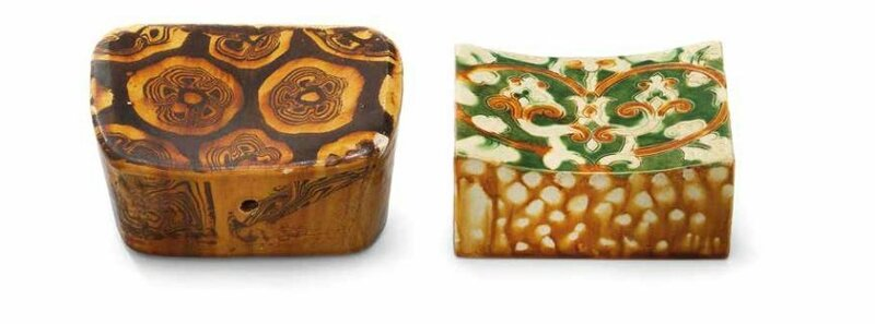 An incised sancai pillow and an amber-glazed marbled pillow, Tang dynasty (618-907)