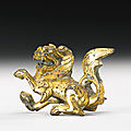 A small gilt-bronze lion, northern wei dynasty (386-534)