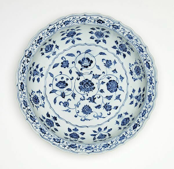 Dish with design of flowers of the four seasons, circa 1400, China, Ming dynasty (1368 - 1644), Yongle period (1403 - 1424), Jingdezhen, Jiangxi Province, porcelain with underglaze blue decoration, 7.5 x 38.0 cm. Purchased 1988, 514.1988. Art Gallery of Ne
