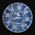 A magnificent large safavid blue and white dish depicting adam, persia, 17th century
