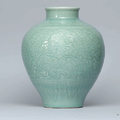 A carved celadon-glazed 'Lotus' jar, Qing dynasty, 18th century
