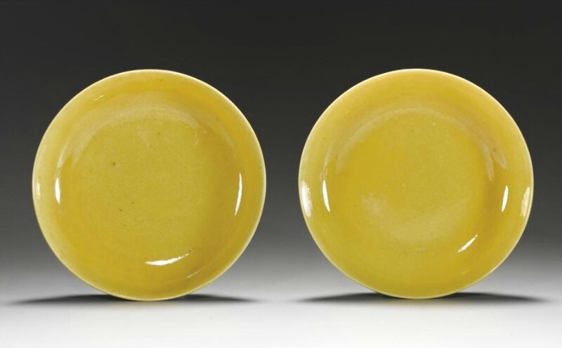 A pair of Imperial yellow saucer dishes, Xuantong marks and period