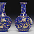 A pair of gilt-decorated blue-ground bottle vases, guangxu six-character marks in gilding and of the period (1875-1908)