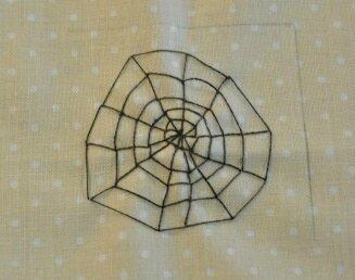 toile d'araignee brodee