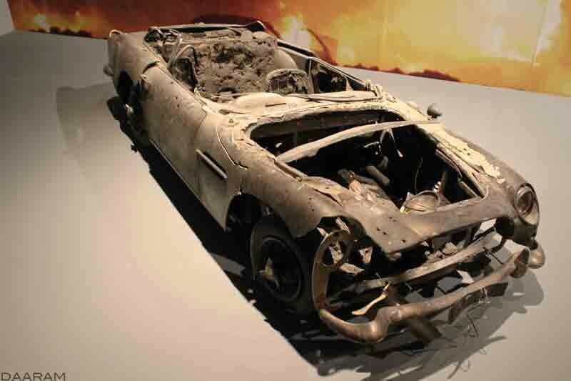 Destroyed scale model of the famous Aston Martin DB5. « Skyfall » 2012. Photo: Olivier Daaram Jollant © 2016
