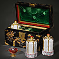 A set of three gold-mounted du paquier porcelain flasks and an agate cup in a japanese lacquer box, vienna, circa 1725-1730
