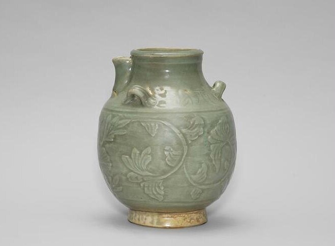 An unusual celadon-glazed lugged ewer, 15th-16th century