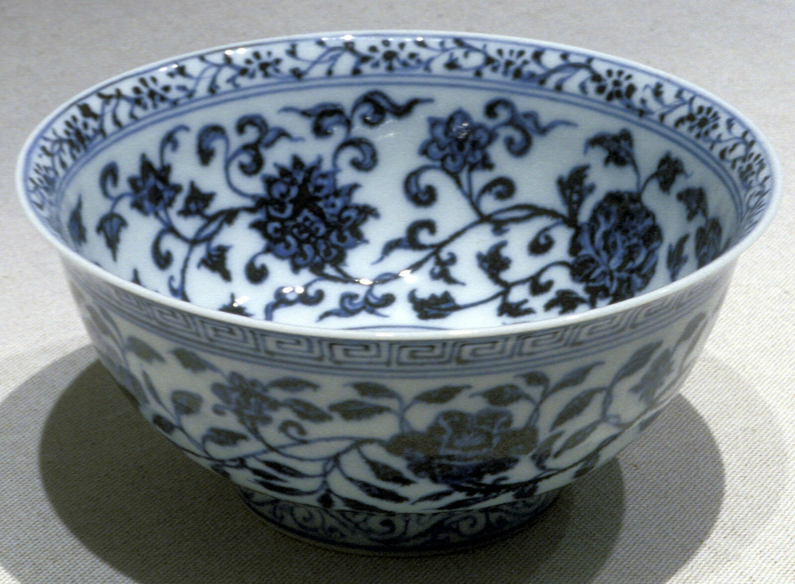 Bowl with stylized lotus and floral designs, Ming dynasty, early 1400s, Yongle period, porcelain with underglaze blue, 3 1/8 x 6 3/4 (diam.) in.. Gift of Mr. and Mrs. Eli Lilly. 60.102. Indianapolis Museum of Art © 2014 IMA