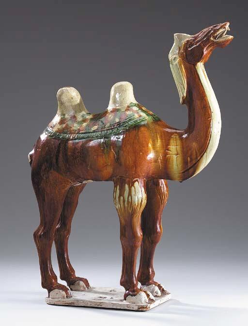A Sancai-Glazed Pottery Figure of a Braying Camel, Tang Dynasty (618-906)