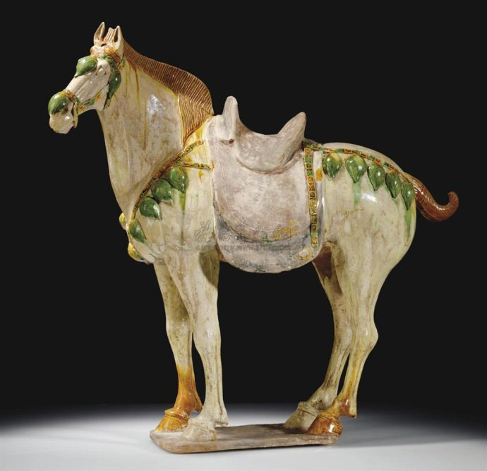 A large sancai-glazed and painted pottery figure of a Ferghana horse, Tang dynasty (618-907)