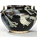 A Lushan phosphatic glaze-splashed brown-glazed foliate-appliqué twin-handled jar, Tang dynasty (618-907)
