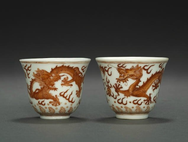 Two iron red 'dragon' wine cups, Guangxu six-character marks and of the period