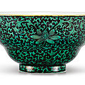 A black-ground green-enamelled 'lotus' ogee bowl, seal mark and period of qianlong (1736-1795)
