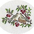 Deux oiseaux sur branches de cerisier...