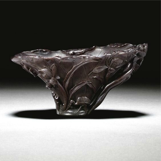 A rhinoceros horn 'Lotus' libation cup, Qing dynasty, 18th century