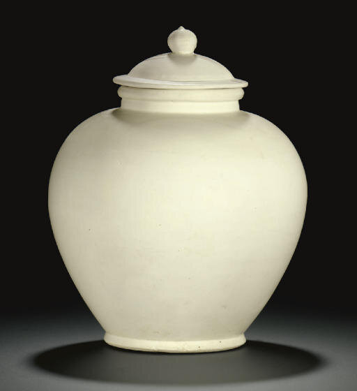 A glazed white ware baluster jar and cover, Tang dynasty (618-907)