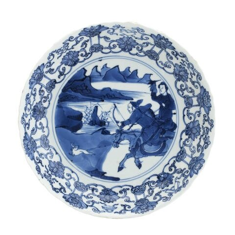 A blue and white 'hunt' dish. Bearing a Chenghua six character mark, but Kangxi. Photo Bonhams.