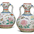 A magnificent pair of famille rose 'butterfly' double-gourd vases, qianlong six-character seal marks and of the period
